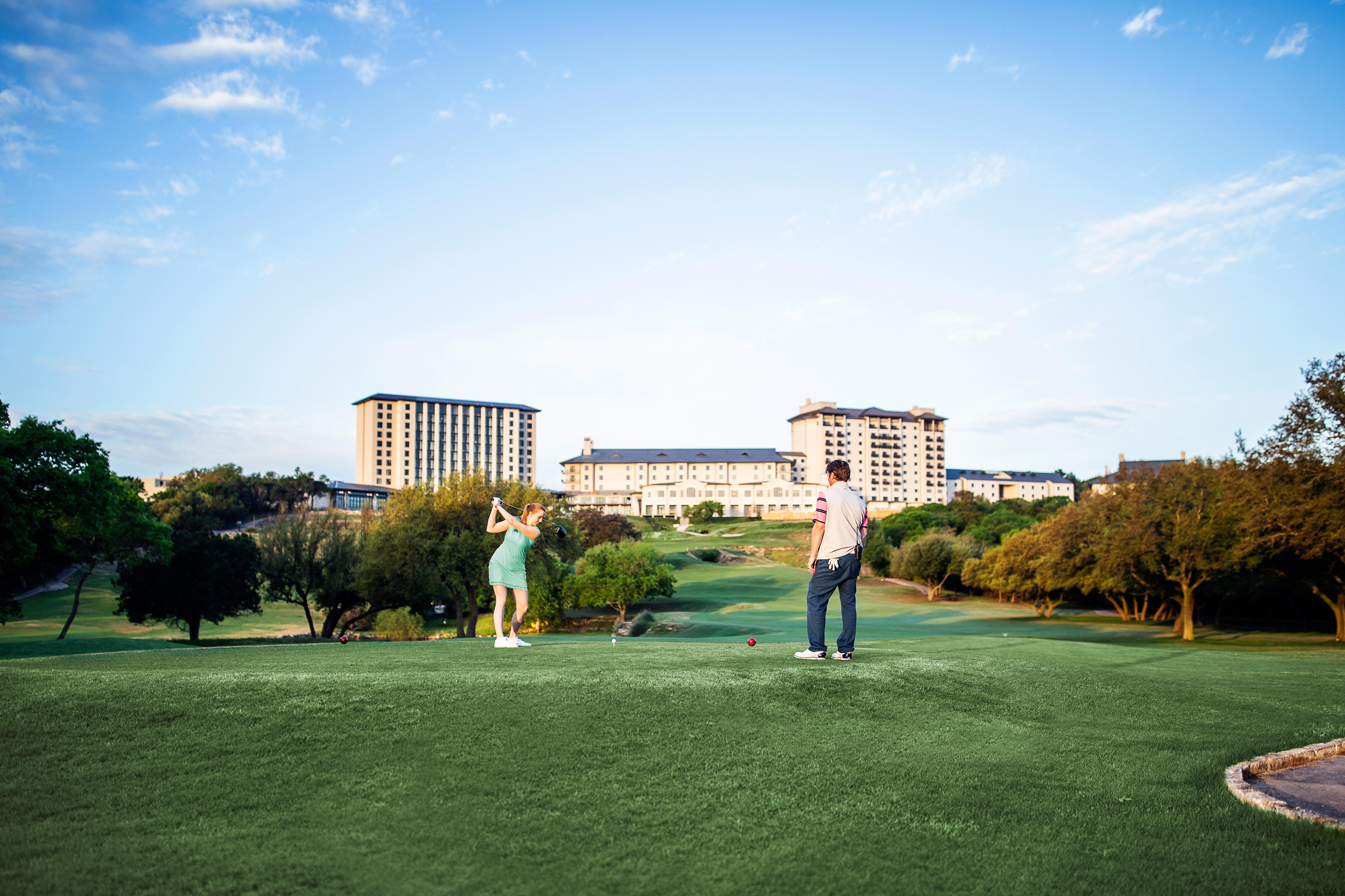 playing golf at Omni Barton Creek